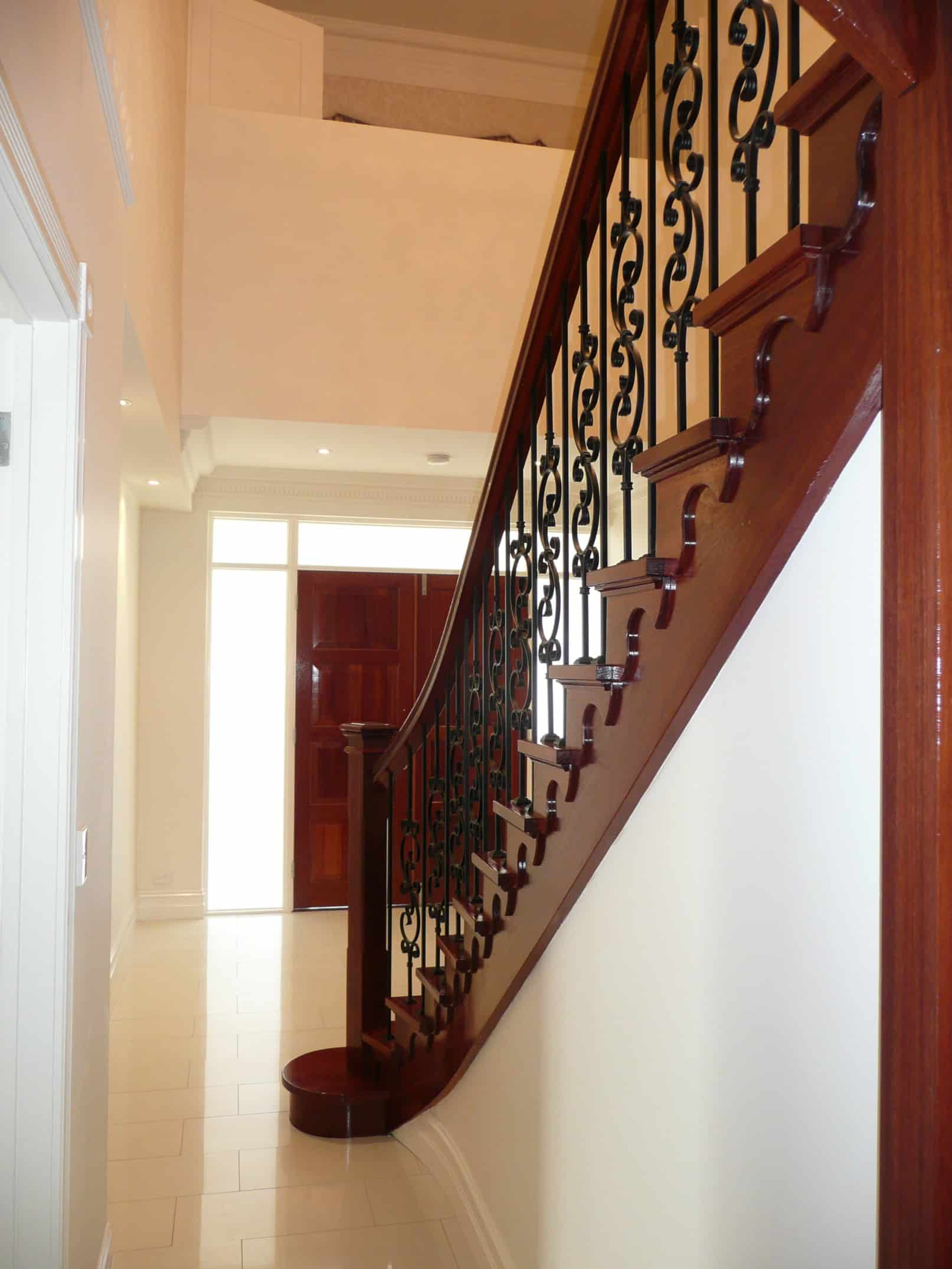 Custom double flared profile cut stair with steel for Custom staircase design